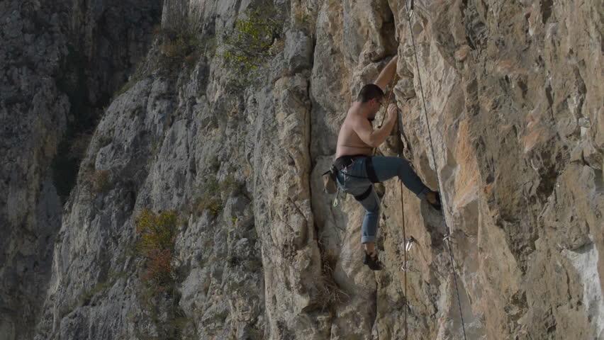 Rock climber in Turzi Gorge, Transylvania, Romania | Shutterstock HD Video #5268797