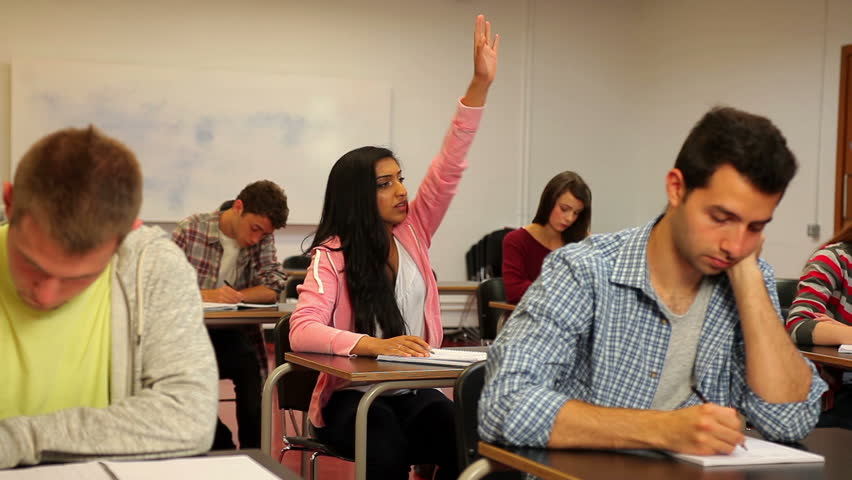 Happy student asking her teacher something in class in a college | Shutterstock HD Video #5270522