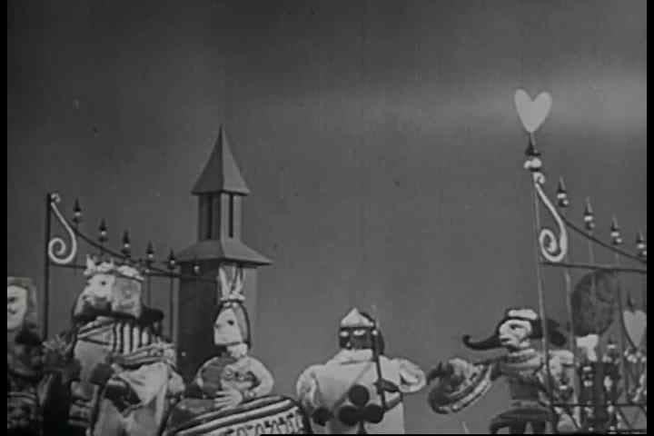 Scenes from a 1950s era stop motion and live action film of Alice and Wonderland.