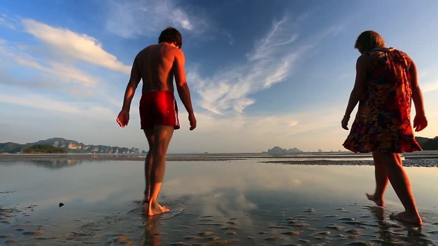 Young couple walking on a beach at sunset in Krabi, Thailand. Low tide. #5275940