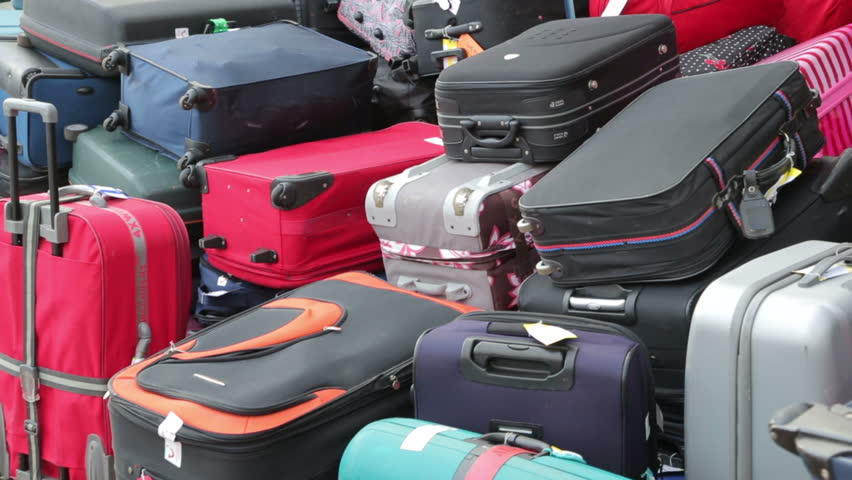 Pan of baggage on cruise ship waiting to be off loaded   Shutterstock HD Video #5277698