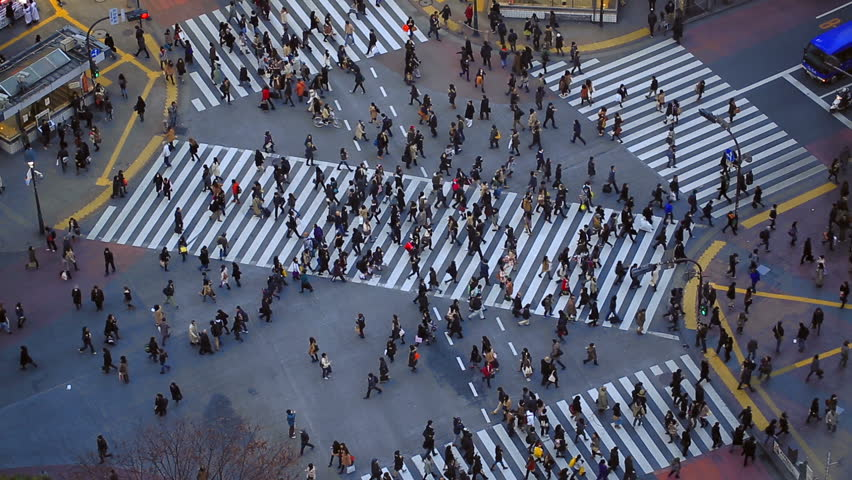 City pedestrian traffic of people crossing the famous Shibuya intersection in Tokyo.
