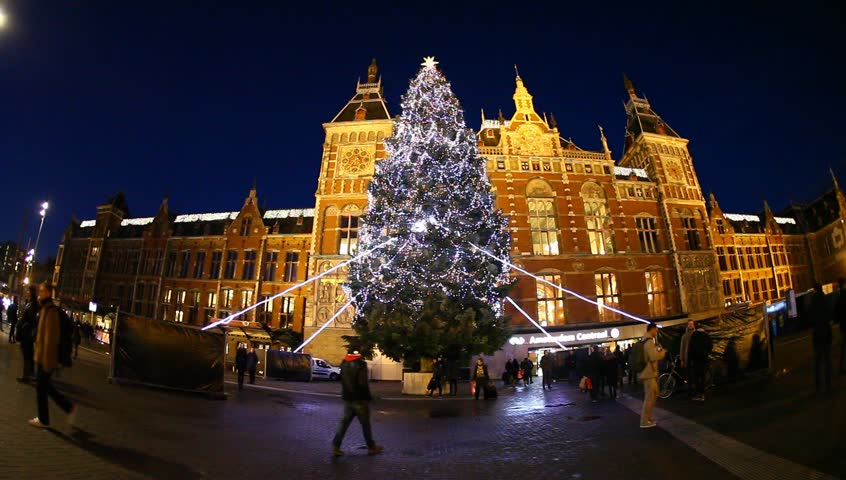 People walk near the Christmas tree on their way to the Central Station, Amsterdam, Holland