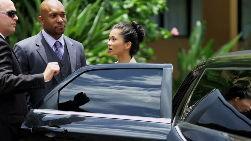 Female Asian Chinese male African American international banking colleagues being collected by personal driver with limousine slow motion shot on RED EPIC, 4K, UHD, Ultra HD resolution | Shutterstock HD Video #5315315