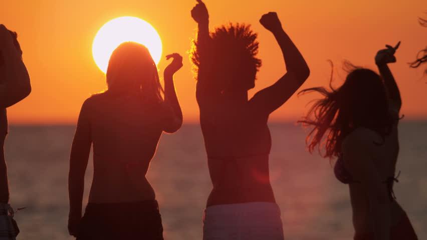 Multi ethnic male female young friends enjoying freedom college break dancing sunset coastal beach shot on RED EPIC, 4K, UHD, Ultra HD resolution | Shutterstock HD Video #5315504