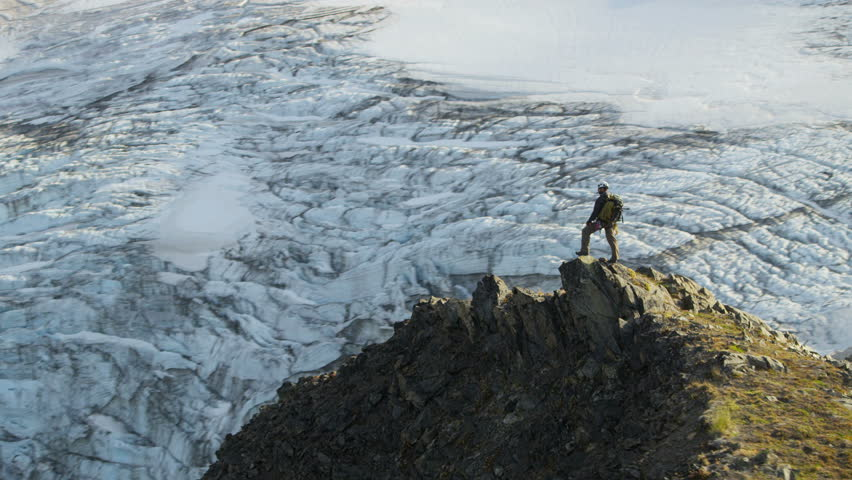 Aerial view of male mountain climber in summer enjoying success high Peaks Troublesome Glacier Chugach Mountains South Central Alaska, USA shot on RED EPIC, 4K, UHD, Ultra HD resolution | Shutterstock HD Video #5318018
