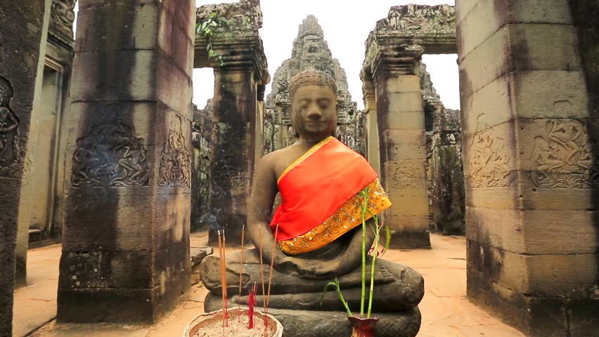 Buddha statue at Bayon Temple.  Bayon ancient Khmer temple, the famous tourist attraction in Cambodia.