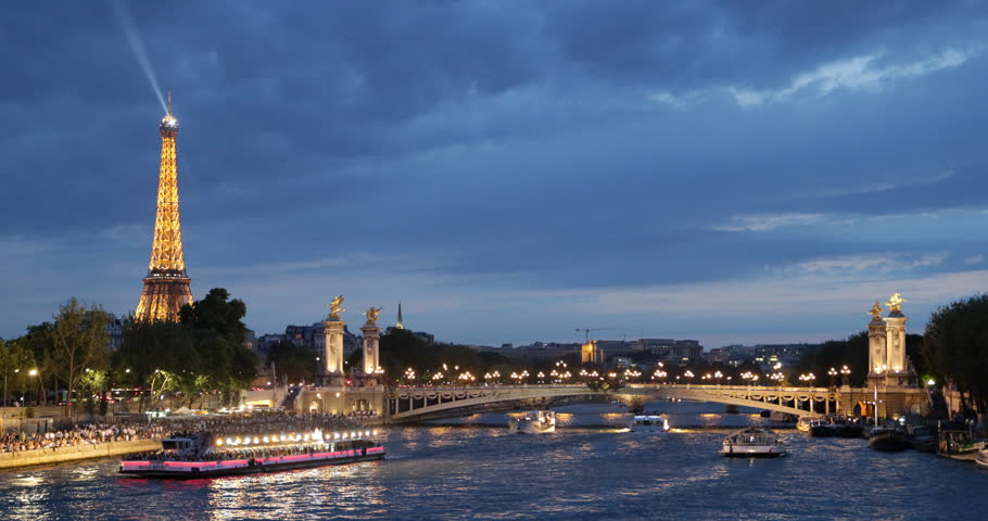 PARIS, FRANCE - JULY 25, 2013 Iconic Eiffel Tower Paris, Tourists Visit in Tour Boats on Seine River Trip French Travel Illuminated Night ( Ultra High Definition, Ultra HD, UHD, 4K, 2160P, 4096x2160 )   Shutterstock HD Video #5326898