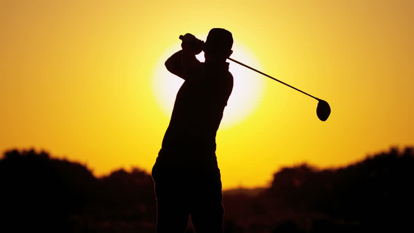 Caucasian male golf professional silhouette holding driver watching his ball after teeing off on fairway sunset slow motion shot on RED EPIC, 4K, UHD, Ultra HD resolution | Shutterstock HD Video #5337926