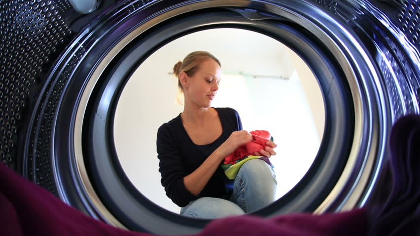 Young woman doing laundry    Shutterstock HD Video #5338820