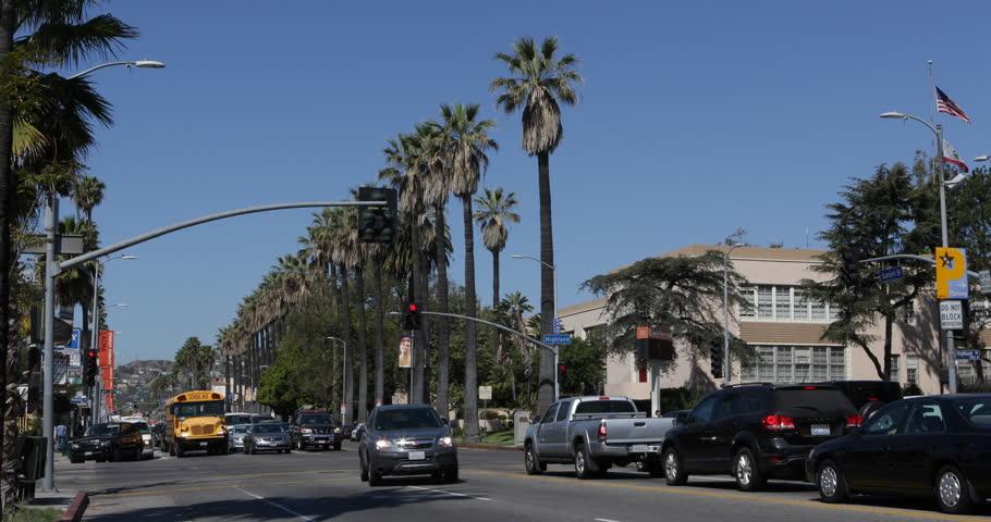 LOS ANGELES, USA - APRIL 15, 2013 Los Angeles, USA, Car Traffic, Hollywood High School Bus on Sunset Strip Boulevard ( Ultra High Definition, Ultra HD, UHD, 4K, 2160P, 4096x2160 )
