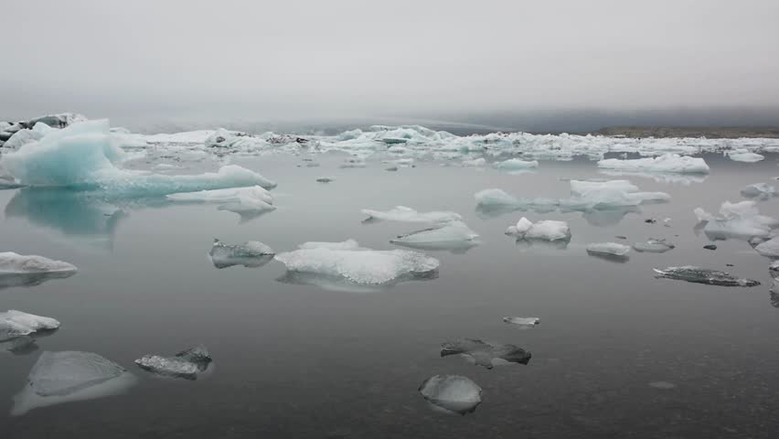 View of the Jokulsarlon (Glacier lagoon) with different floating peaces of ice on a cloudy evening, Iceland   Shutterstock HD Video #5342285