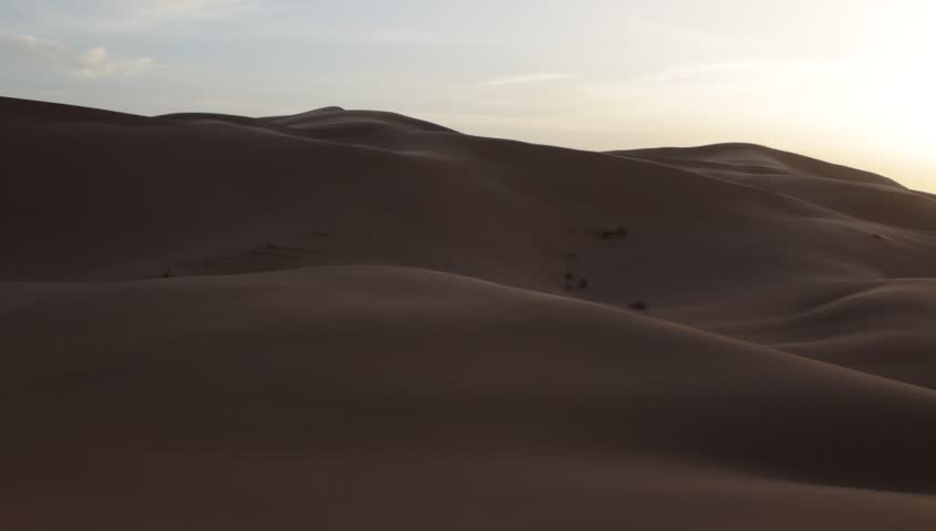 Desert dune during a windy day. Pan view. Erg Chebbi, Maroc. HD1080p Canon 5Dmk4   Shutterstock HD Video #5356208