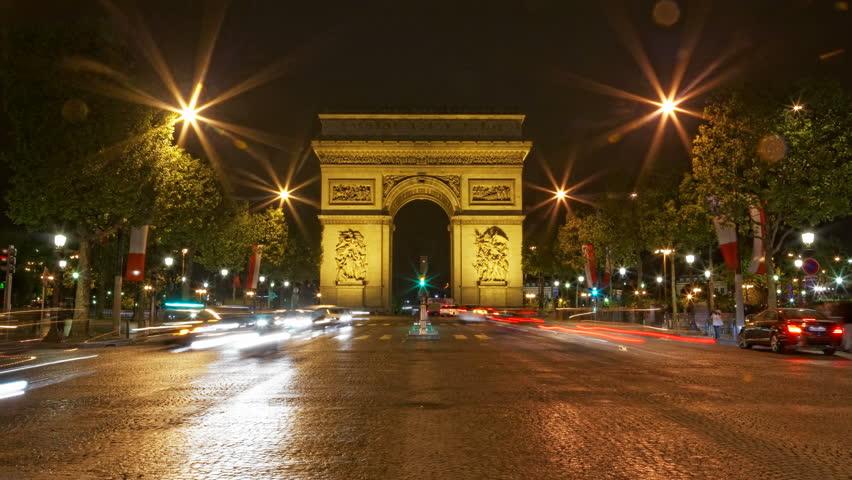 Paris, France - CIRCA 2013: Arch of Triumph at night, Traffic time lapse 4K UHD motion blur | Shutterstock HD Video #5365157