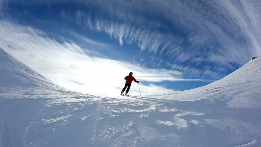 Freerider skier moving down in snow powder; fish-eye lens. HD1080p Canon 5Dmk2 | Shutterstock HD Video #5371553