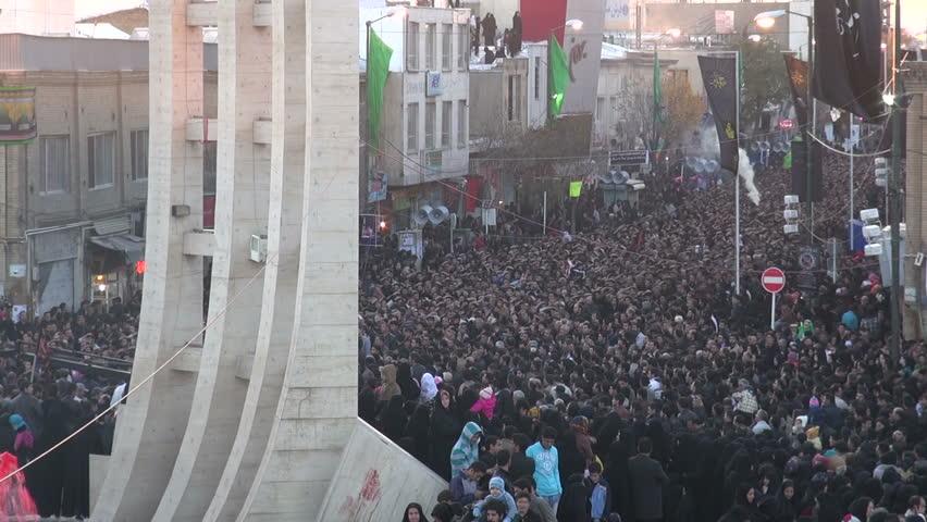 ZANJAN, IRAN - 15 NOVEMBER 2013: Massive crowds have gathered to commemorate the martyrdom of Hussain, a key figure in Shia Islam, in the streets of Zanjan, Iran #5388029