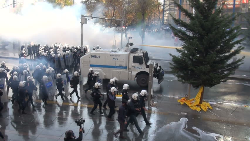 ANKARA, TURKEY - 23 NOVEMBER 2013: Riot police use water cannons and tear gas as they move in on government protesters, during a teachers demonstration in Ankara, capital city of Turkey
