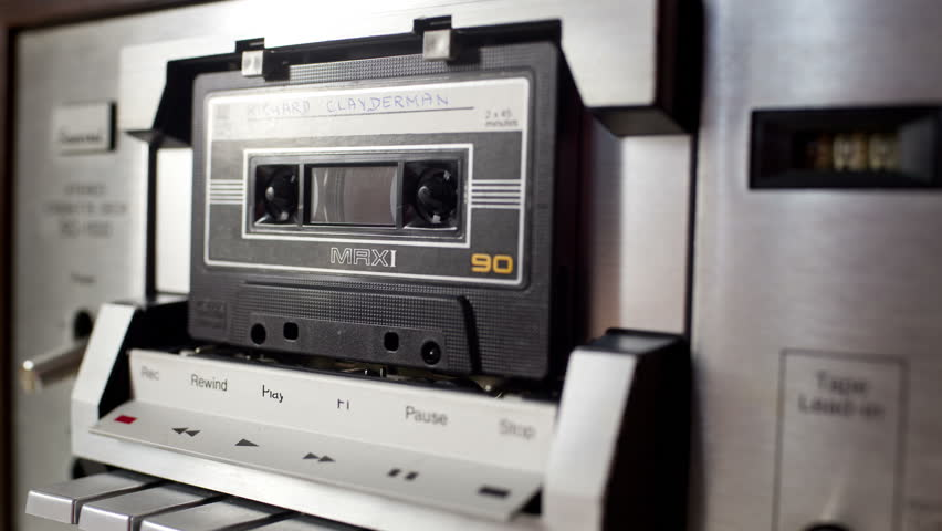 Sequence of old audio cassettes in a retro tape player. this is a super high quality 4k version at 4096x2304 pixels | Shutterstock HD Video #5413709