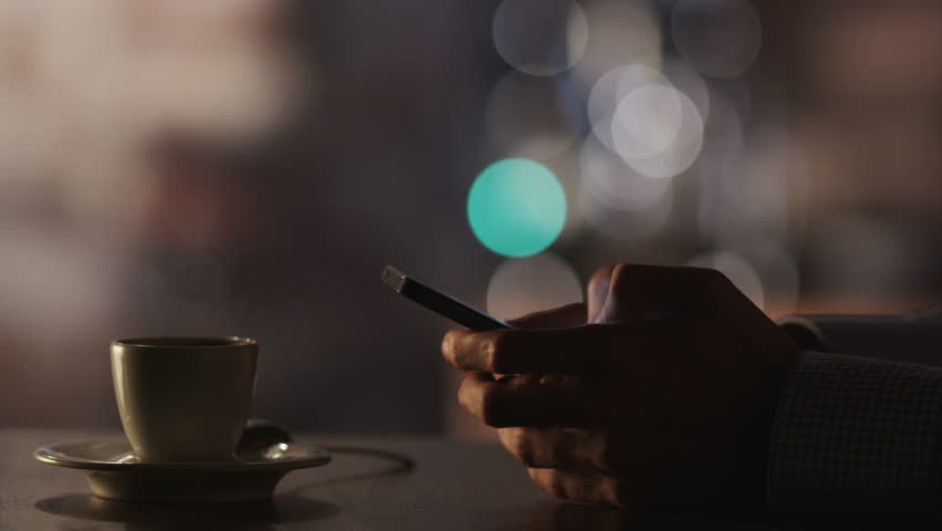 Man Typing a Message Using Mobile Phone at Evening Time in Coffee House.Close-Up. Shot on RED Digital Cinema Camera in 4K, ultra-high definition, UHD | Shutterstock HD Video #5429633