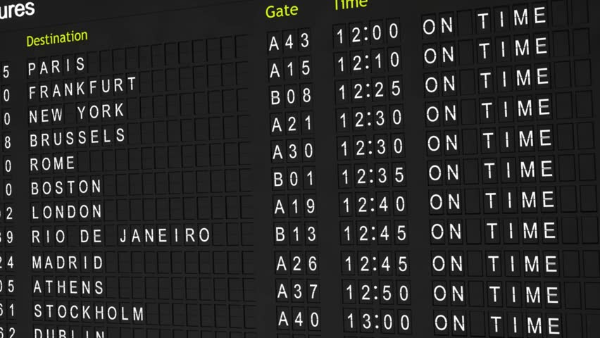 "High definition video of a flight information board with the status of all flights changing from ""On Time"" to ""Delayed"". 