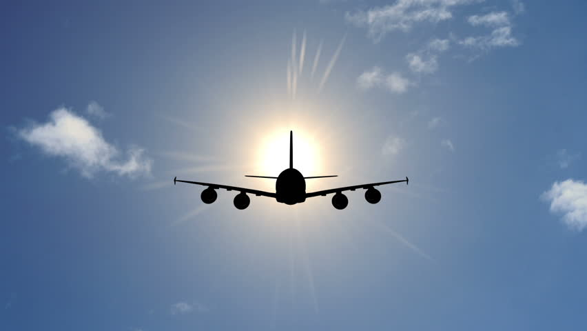 Airplane in Sky with Sun Stock Footage