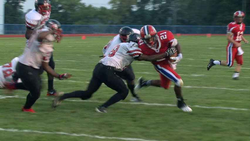 LANGHORNE, PENNSYLVANIA - AUGUST 30 RB D'Andre Pollard (#21, Redskins) at Neshaminy High School breaks 5 tackles and runs into the end zone for a touchdown against Northeast HS, on August 30th, 2013.