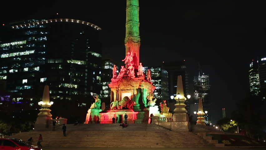 Monument of the independence angel in Mexico city, illuminated by colors