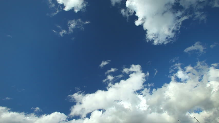 Timelapse of white fluffy clouds moving fast in the blue sky #5456249