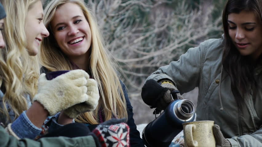 Teen Girl Pours Hot Chocolate For Her Friends Outdoors   Shutterstock HD Video #5460134