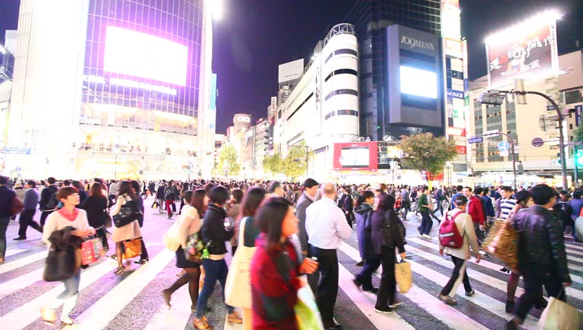 TOKYO - NOV 8 : Pedestrians at the famed crossing of Shibuya district November 8, 2013 in Tokyo, Japan. Shibuya is a fashion center and nightlife area. #5467592