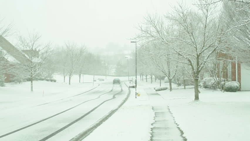 Car swerving in the distance, icy roads | Shutterstock HD Video #5470307