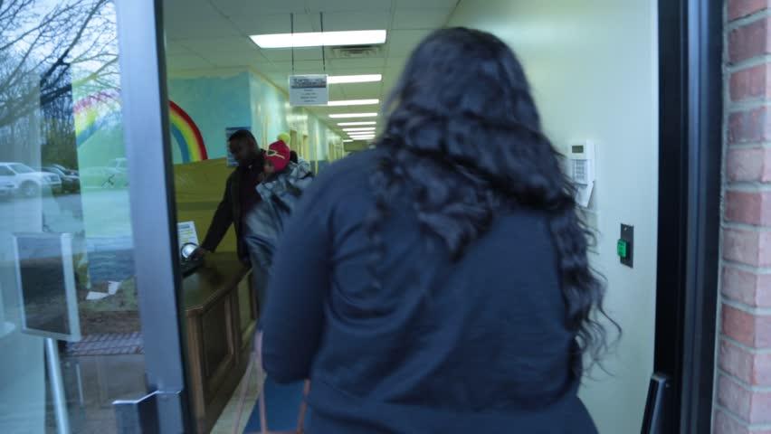 Memphis, TN - Circa 2013 - Parents enrolling their children into the church nursery security system at a African/American church in Memphis, TN