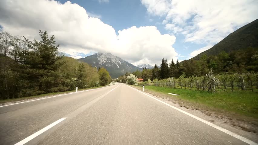 Video footage of driving on a highway in the alps in austria