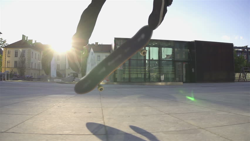 Skateboarder does flip at sunset Royalty-Free Stock Footage #5486102