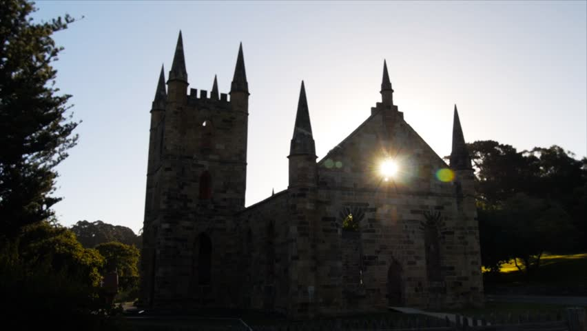 The summer sun sets behind the ruins of the old church at port arthur, tasmania   Shutterstock HD Video #5496668