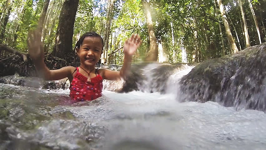 little asiangirl swimming in slow motion