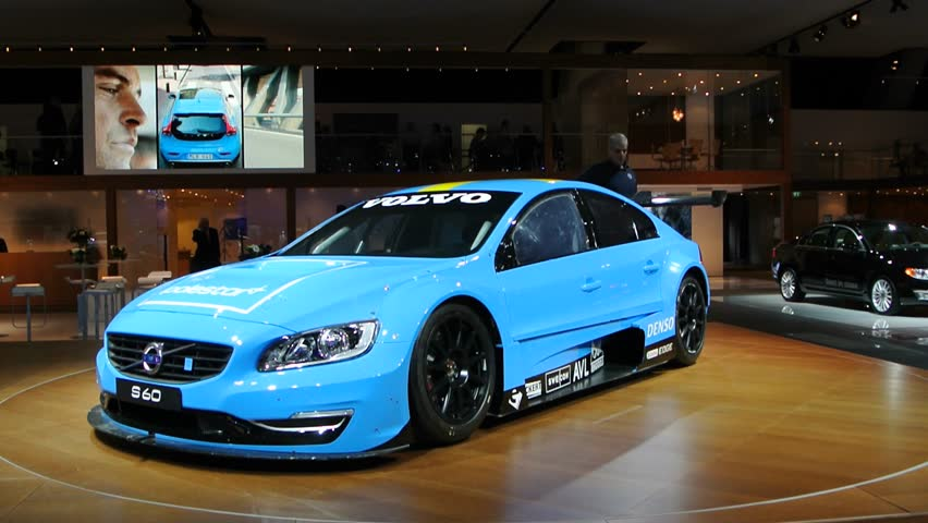 BRUSSELS, BELGIUM - JANUARY 14, 2014: Bright blue Volvo Polestar Racing S60s on display at the 2014 Brussels motor show. The S60 Polestar is the sporty version of the Volvo S60 T6 AWD sedan.  #5502752