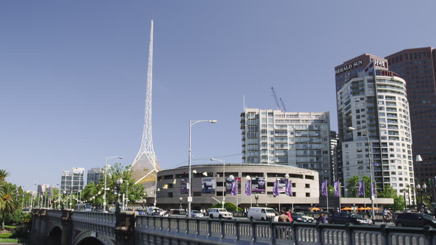 MELBOURNE, AUSTRALIA - OCT 2009: Trams on Princess Bridge with The Arts Center and the Spire | Shutterstock HD Video #5503589