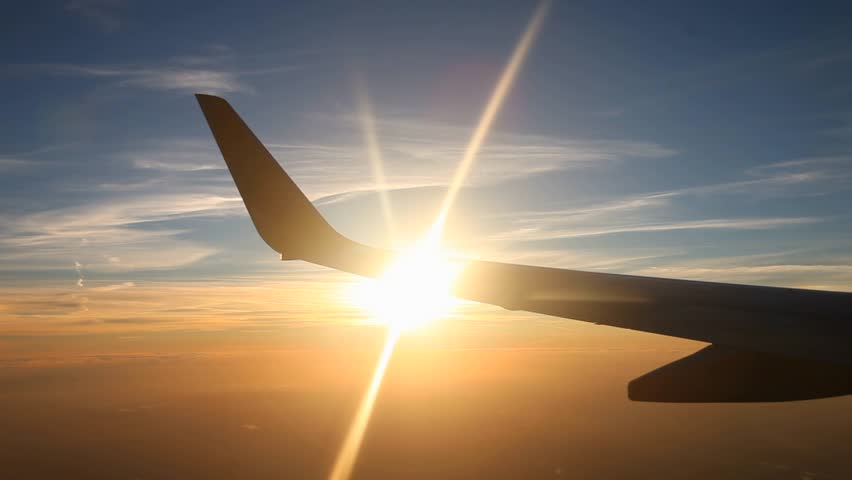 video footage of a airplane with sun #5509196