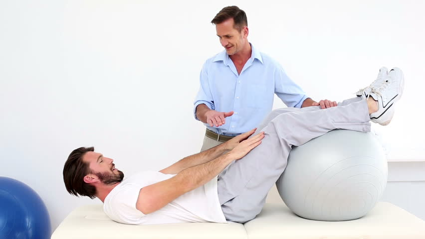 Physical Therapist Helping His Patient Stock Footage Video (100%  Royalty-free) 5520731 | Shutterstock