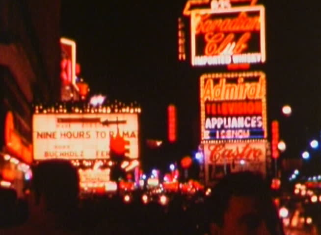 NEW YORK - CIRCA 1960s: Shot in the 1960s (specific year unknown) in Times Square, New York at night.