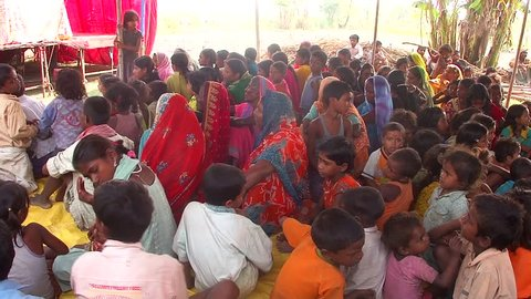 RAXAUL, INDIA-OCT 27: Local people and children at a festival on 27th Oct 2011 in Raxaul, Bihar State, India. Bihar is one of the poorest states in India. The per capita income is about 115 dollars.