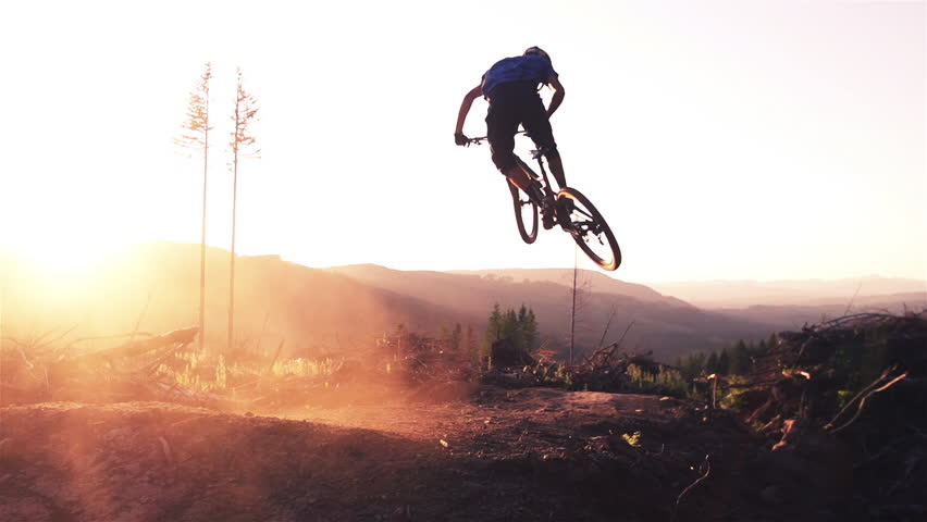Mountain biker jumping at sunset in super slow motion #5566250