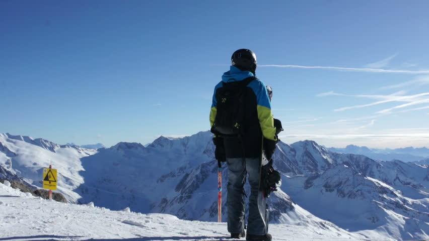 Man with snowboard standing on top of snowy mountain, Hintertux glacier, Tirol, Austria  | Shutterstock HD Video #5568224