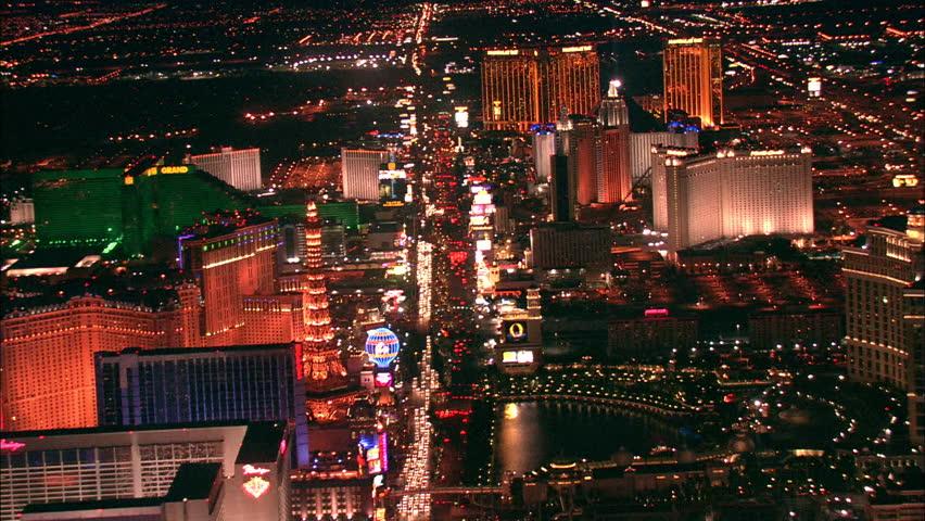 LAS VEGAS, USA - 1 January 2011 - Hotel Strip Night Las Vegas. Aerial footage of the Las Vegas strip at night. Beautiful hotel and skyscrapers light up the city skyline. | Shutterstock HD Video #5575448