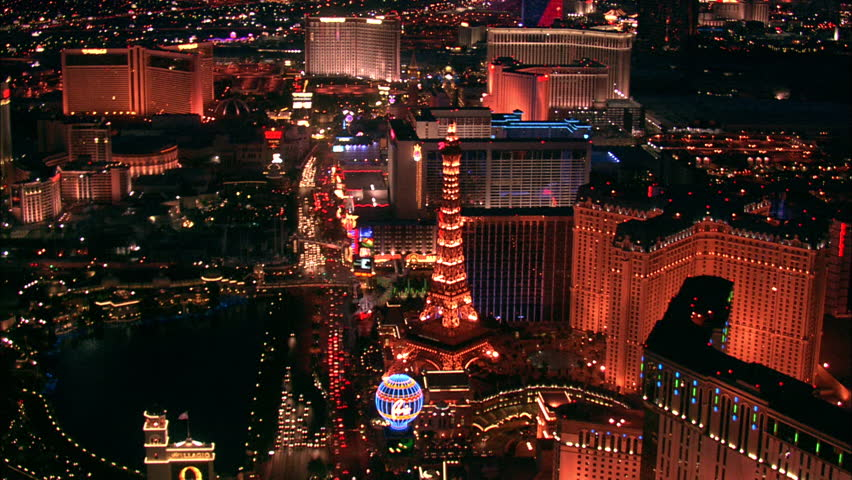 LAS VEGAS, USA - 1 January 2011 - Hotel Strip Night Las Vegas. Aerial footage of the Las Vegas strip at night. Beautiful hotel and skyscrapers light up the city skyline. | Shutterstock HD Video #5575589