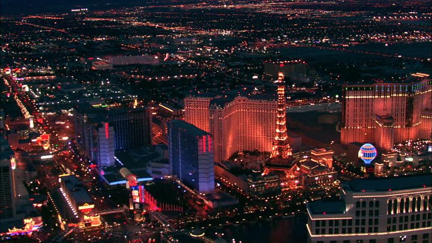 LAS VEGAS, USA - 1 January 2011 - Las Vegas Hotel Strip Night. Aerial footage of the Las Vegas strip at night. Beautiful hotel and skyscrapers light up the city skyline. | Shutterstock HD Video #5575592