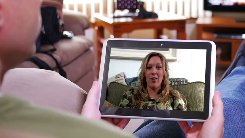 A man video chats on his tablet PC inside his home. Screen image customizable upon request. | Shutterstock HD Video #5595932
