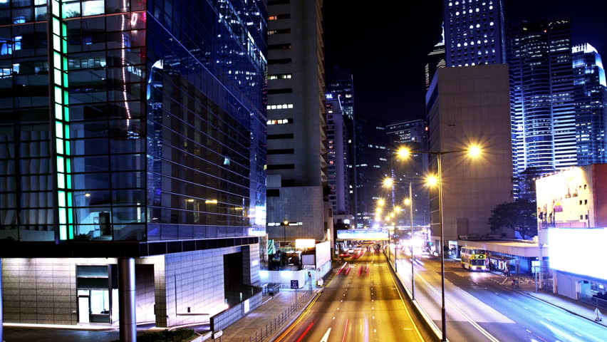 Hong Kong City Night Timelapse. Zoom in shot. Corporate buildings and busy traffic at rush hour. | Shutterstock HD Video #5598728