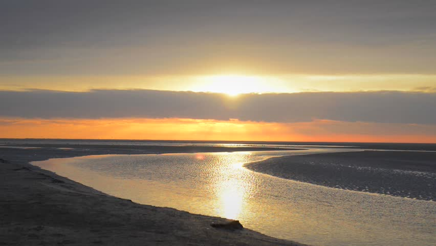 Colorful sunset over the beach at the island of Schiermonnikoog in the North of The Netherlands. | Shutterstock HD Video #5625749